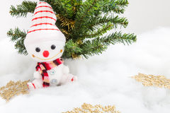 Smiling snowman with snowflake decoration and christmas tree Royalty Free Stock Photos