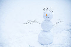 Smiling snowman standing in the snow. Handmade smiling snowman standing in the snow Royalty Free Stock Photography