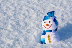 Smiling snowman standing in winter christmas landscape with copy. Space Stock Photos