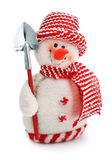 Smiling snowman toy dressed in scarf and cap. Isolated on white background Stock Photos