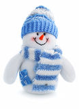 Smiling snowman toy dressed in scarf and cap. Isolated on white background Royalty Free Stock Images