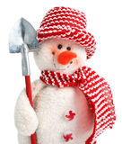 Smiling snowman toy with shovel Royalty Free Stock Image