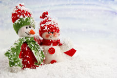 Smiling snowmen in the snow. No name toy Stock Image