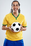 Smiling soccer player Stock Photo