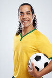 Smiling soccer player Royalty Free Stock Image