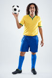 Smiling soccer player Stock Photography