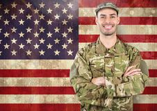 Smiling soldier against american flag Royalty Free Stock Photos