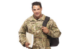 Smiling soldier with bag and books Royalty Free Stock Image