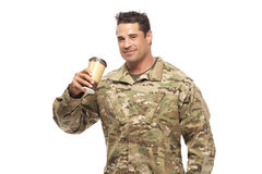 Smiling soldier drinking coffee Stock Photography