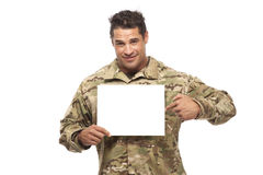 Smiling soldier pointing at placard Stock Photography
