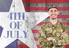 Smiling soldier standing on american flag background Royalty Free Stock Photos