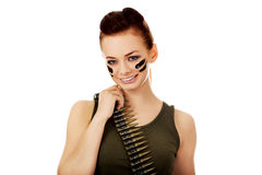Smiling soldier woman with bullet belt Stock Images