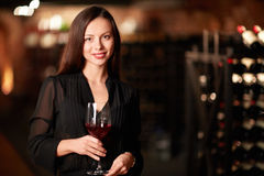 Smiling sommelier. Beautiful girl with a glass of wine Stock Photography