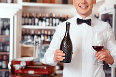 Smiling sommelier holding glass of wine Royalty Free Stock Photo