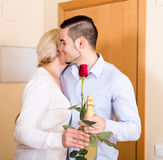 Smiling son and senior mother Stock Image