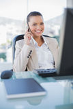 Smiling sophisticated businesswoman on the phone. In bright office Stock Photos