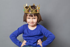 Smiling spoiled kid with golden crown on Stock Photos