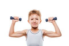 Smiling sport boy with strong biceps muscles holding exerc Stock Photo