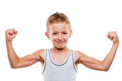 Smiling sport child boy showing hand biceps muscles strength. Beauty smiling sport child boy showing his hand biceps muscles strength white isolated Stock Images