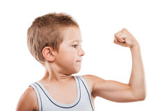 Smiling sport child boy showing hand biceps muscles strength Stock Images