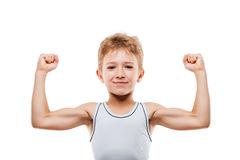 Smiling sport child boy showing his hand biceps muscles strength. Beauty smiling sport child boy showing his hand biceps muscles strength white isolated Royalty Free Stock Photography