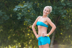 Smiling sport woman in the park Stock Images