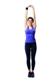 Smiling sport woman stretching hands Royalty Free Stock Images