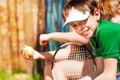 Smiling sportive boy waiting for the tennis match Stock Images