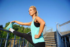 Smiling sportive woman having workout on the steps Stock Image