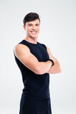 Smiling sports man standing with arms folded Stock Image
