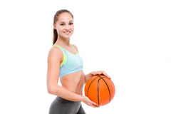 Smiling sports woman holding basketball ball Royalty Free Stock Photos