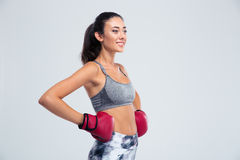 Smiling sports woman standing in boxing gloves Stock Photo
