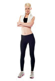 Smiling sports woman standing with folded arms Stock Photos