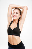 Smiling sports woman stretching hands Royalty Free Stock Photo