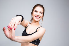 Smiling sports woman stretching hands Royalty Free Stock Photography
