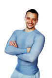 Smiling sportsman with arms folded Royalty Free Stock Photography