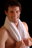 Smiling sportsman with towel Royalty Free Stock Image