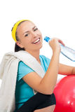 Smiling sportswoman drinking water after training Stock Photos