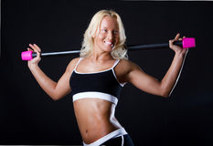 Smiling sportswoman exercising Stock Photo