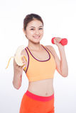Smiling sporty asian  woman holding banana over white background. And looking at camera Stock Photo