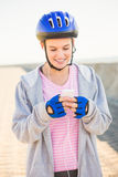 Smiling sporty blonde skater enjoying music Stock Images