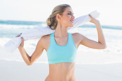 Smiling sporty blonde in sportswear holding towel Royalty Free Stock Photography