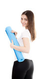Smiling sporty girl with yoga mat Stock Photos