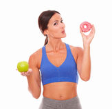 Smiling sporty lady wanting to eat donut Stock Images