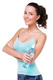 Smiling sporty woman with a bottle of water Royalty Free Stock Image