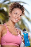 Smiling sporty woman with bottle of water Stock Image