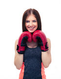 Smiling sporty woman with boxing gloves Stock Image