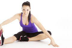 Woman streching her leg Stock Photography