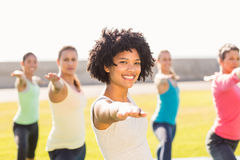 Smiling sporty woman doing yoga in yoga class Stock Images