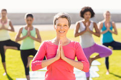 Smiling sporty woman doing yoga in yoga class Stock Image